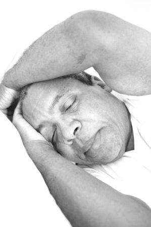 sleep: African american male sleeping in his bed