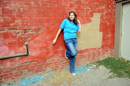 tomboy: Rebellious female teenager posing outside. Stock Photo