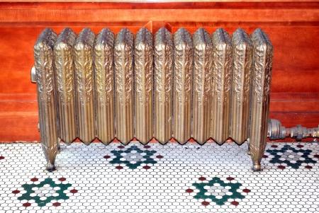 Vintage radiator heater displayed indoors.