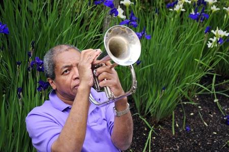 flugelhorn: African american male blowing his flugelhorn  Stock Photo
