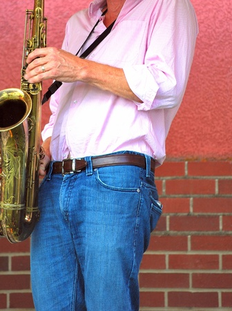 Saxophone player performing in concert. photo