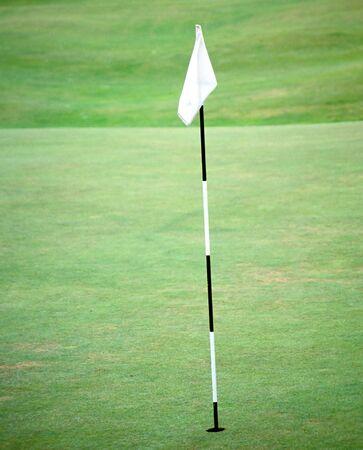 Golf flag pole on the fairway green
