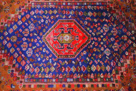 oriental rug: Persian carpet displayed indoors. Stock Photo