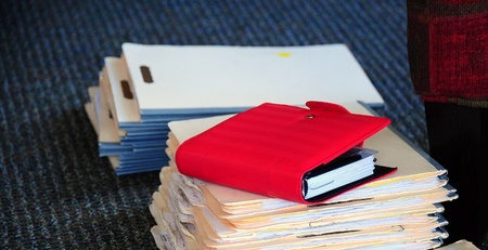 Confidential files on the office floor.