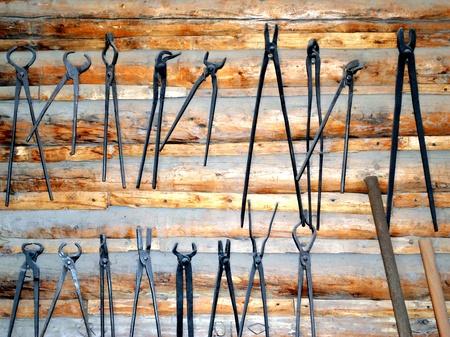Blacksmith tools displayed indoors. Imagens