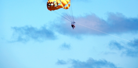 parasailing: Couple parasailing high in the sky. Stock Photo