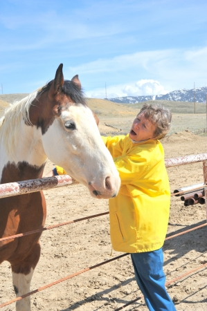 rancher: Mature female rancher with her horse outside