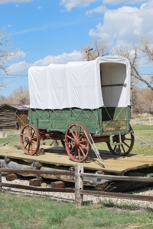 covered wagon: Covered wagon on display outdoors  Stock Photo