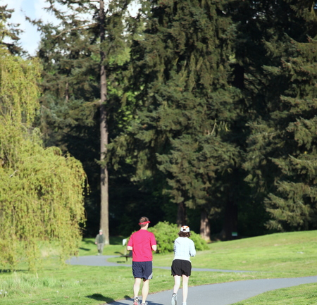 Couple jogging in the park outdoors