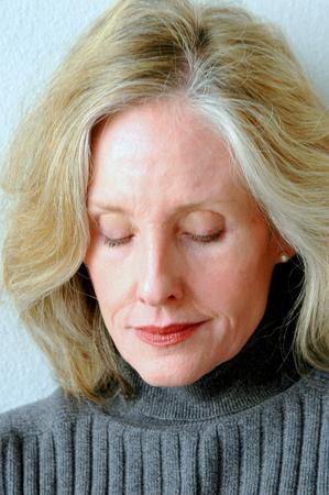 Mature female blond beauty expressions indoors  Reklamní fotografie