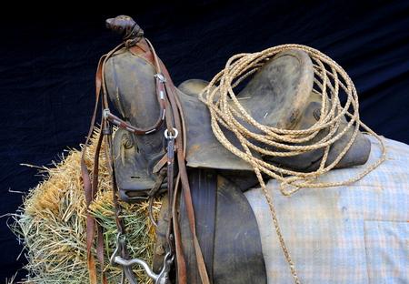western saddle: Western saddle displayed inside a barn. Stock Photo