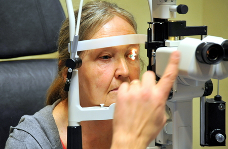 Mature female getting an eye exam.