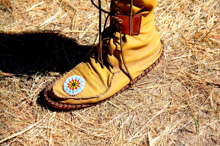 moccasins: Native american man wearing moccasins outdoors.