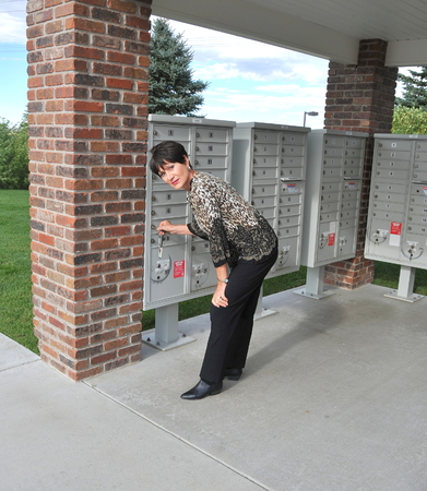 Female beauty at her mailbox outside. photo