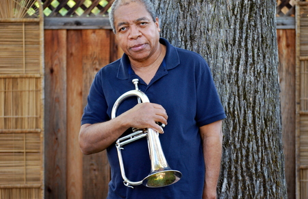 flugelhorn: African american male expressions outside. Stock Photo