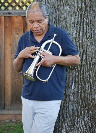 flugelhorn: African american jazz musician expressions outside.