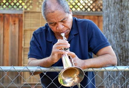 flugelhorn: Jazz musician blowing his flugelhorn outside. Stock Photo