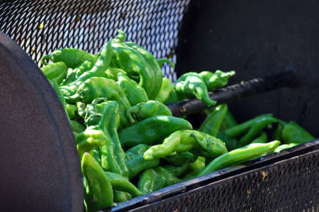 roasting: Hot peppers roasting in a bin outdoors. Stock Photo