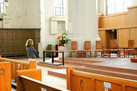 reflecting: Female beauty reflecting inside a church.