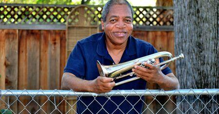 flugelhorn: Jazz musician with his flugelhorn outside.