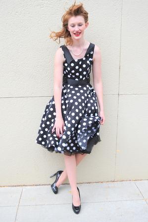 malfunction: Female beauty  having a dress malfunction outside.