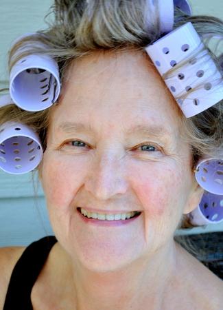 hair rollers: Female beauty wearing hair rollers.
