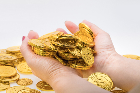concept of Income from investment, hand holding golds