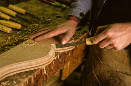 gouge: hands of a cabinetmaker to work