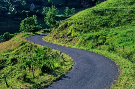 macadam: winding road in the Cantal, France Stock Photo