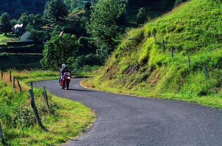 cantal: bike ride on a winding road of Cantal, France.