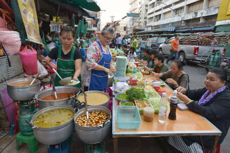Chiang Mai, Thailand  Women selling food at a street stall on February 15, 2014 in Chiang Mai, Thailand Éditoriale