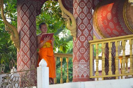 monastic: Luang Prabang, Laos  Unidentified buddhist novice at a monastic school on February 28, 2014 in Luang Prabang, Laos