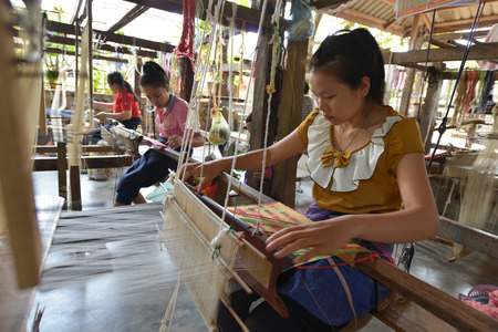 Luang Prabang, Laos  Unidentified woman worker in silk production factory on March 1, 2014 in Luang Prabang, Laos