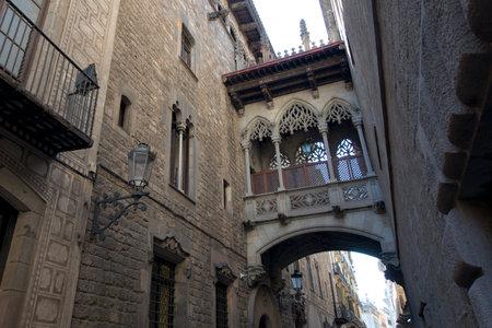 carrer: Neogothic bridge at Carrer del Bisbe Bishop Street Barcelona, Catalonia, Spain