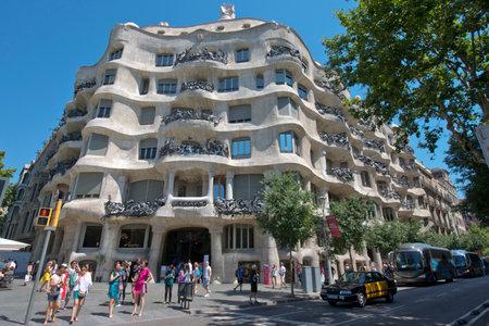Barcelona, Spain - June 26: Casa Mila La Pedrera in Eixample, Barcelona on June 26, 2015. Casa Mila, an aristocratic apartment building, is one of Antoni Gaudi's Most Famous works