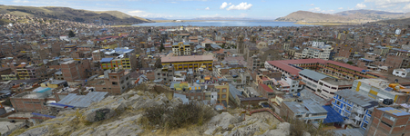 squalid: Puno, Peru. Puno located on the shore of Lake Titicaca. It is the principal city of the Puno Region