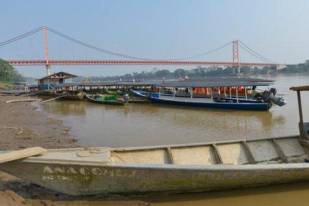 oxbow: PUERTO MALDONADO, PERU - SEPTEMBER 18: Boats in the Madre de Dios River near the Guillermo Billinghurst Bridge on September 18, 2015 in Puerto Maldonado, Peru Editorial