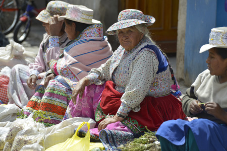 september 2: CHIVAY, PERU - SEPTEMBER 2: Unidentified Quechua people in Chivay market on September 2, 2015, Arequipa Region, Peru