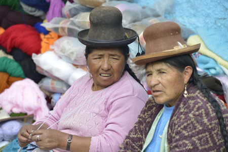 quechua: CHIVAY, PERU - SEPTEMBER 2: Unidentified people in Chivay Quechua market on September 2, 2015, Arequipa Region, Peru. National clothes are common for Quechua people in rural Peru
