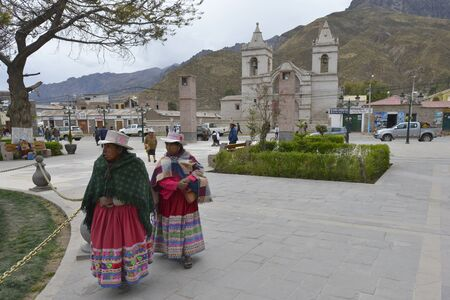 september 2: CHIVAY, PERU - SEPTEMBER 2: Unidentified Quechua people in Chivay on September 2, 2015, Arequipa Region, Peru. National clothes are common for Quechua people in rural Peru