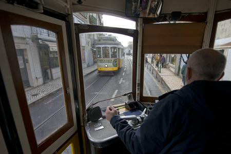 operates: LISBON, PORTUGAL - JANUARY 23: Traditional Tram Through the streets of Lisbon on January 23, 2016 in Lisbon, Portugal. The Lisbon tramway network Operates since 1873.