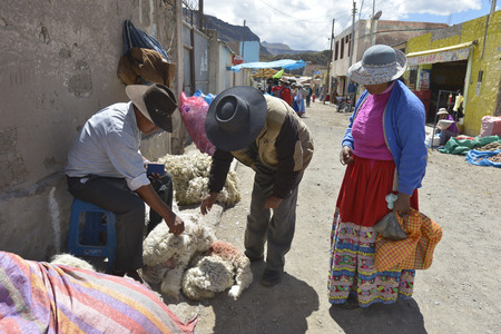 common market: CHIVAY, PERU - SEPTEMBER 2: Unidentified people in Chivay Quechua market on September 2, 2015, Arequipa Region, Peru. National clothes are common for Quechua people in rural Peru.