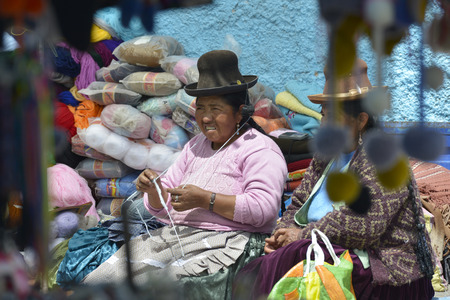 september 2: CHIVAY, PERU - SEPTEMBER 2: Unidentified people in Chivay Quechua market on September 2, 2015, Arequipa Region, Peru. National clothes are common for Quechua people in rural Peru