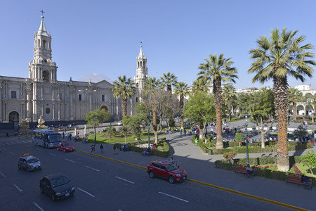 plaza of arms: AREQUIPA, PERU - SEPTEMBER 1: People roaming in Plaza de Armas in front of the Cathedral of Arequipa on September 1, 2015 in Arequipa, Peru.
