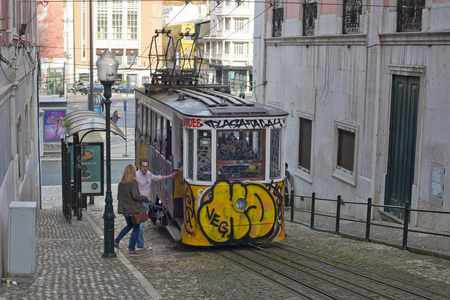 baixa: LISBON, PORTUGAL - JANUARY 23: Traditional Tram Through the streets of Lisbon on January 23, 2016 in Lisbon, Portugal. The Lisbon tramway network Operates since 1873.