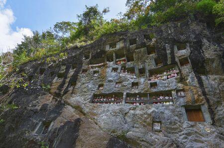 toraja: Galleries of tau-tau guard the grave. Lemo burial site is old cliffs in Tana Toraja, Sulawesi, Indonesia