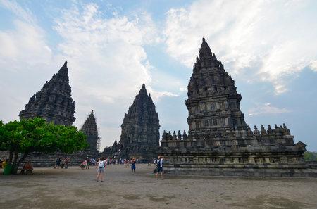prambanan: Yogyakarta, Java, Indonesia - August 7: Tourists visiting the Prambanan temple on August 7, 2016 in Yogyakarta, Java, Indonesia