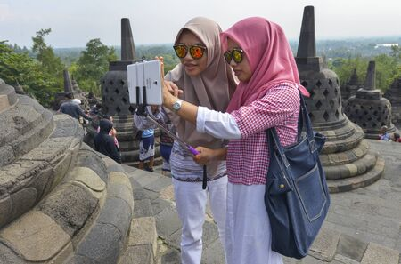 6 people: Yogyakarta, Java, Indonesia - August 6: People visiting Taman Sari Water Castle Also known as on August 6, 2016 in Yogyakarta, Java, Indonesia