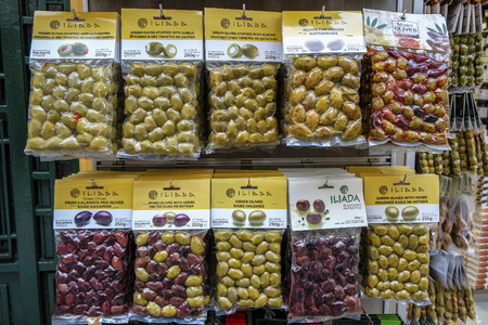 Athens, Greece - December 28: Many varieties of olives packaged for sale in a food shop in the Plaka district on December 28, 2017 in Athens, Greece.