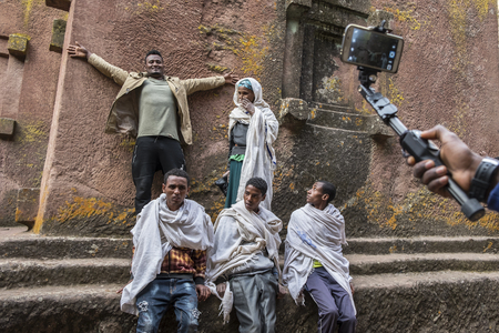Lalibela, Ethiopia - January 5: A group of pilgrims making a picture in Bet Giyorgis, one of the churches carved into the rock of Lalibela on January 5, 2018 in Lalibela, Ethiopia. Editorial